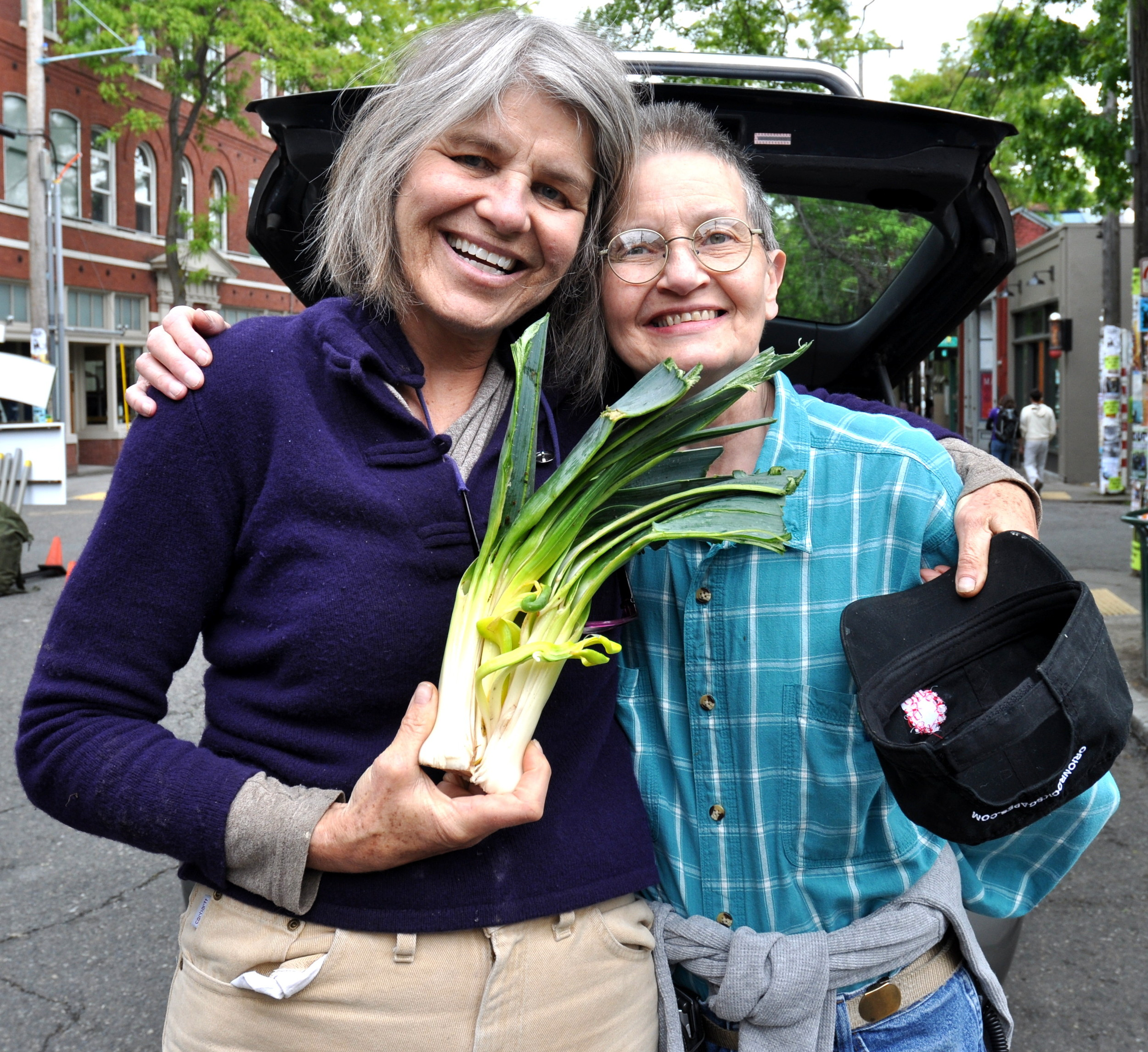 Sustainable Ballard collect food for Ballard Food Bank every Sunday at Ballard Farmers Market. Copyright Zachary D. Lyons.
