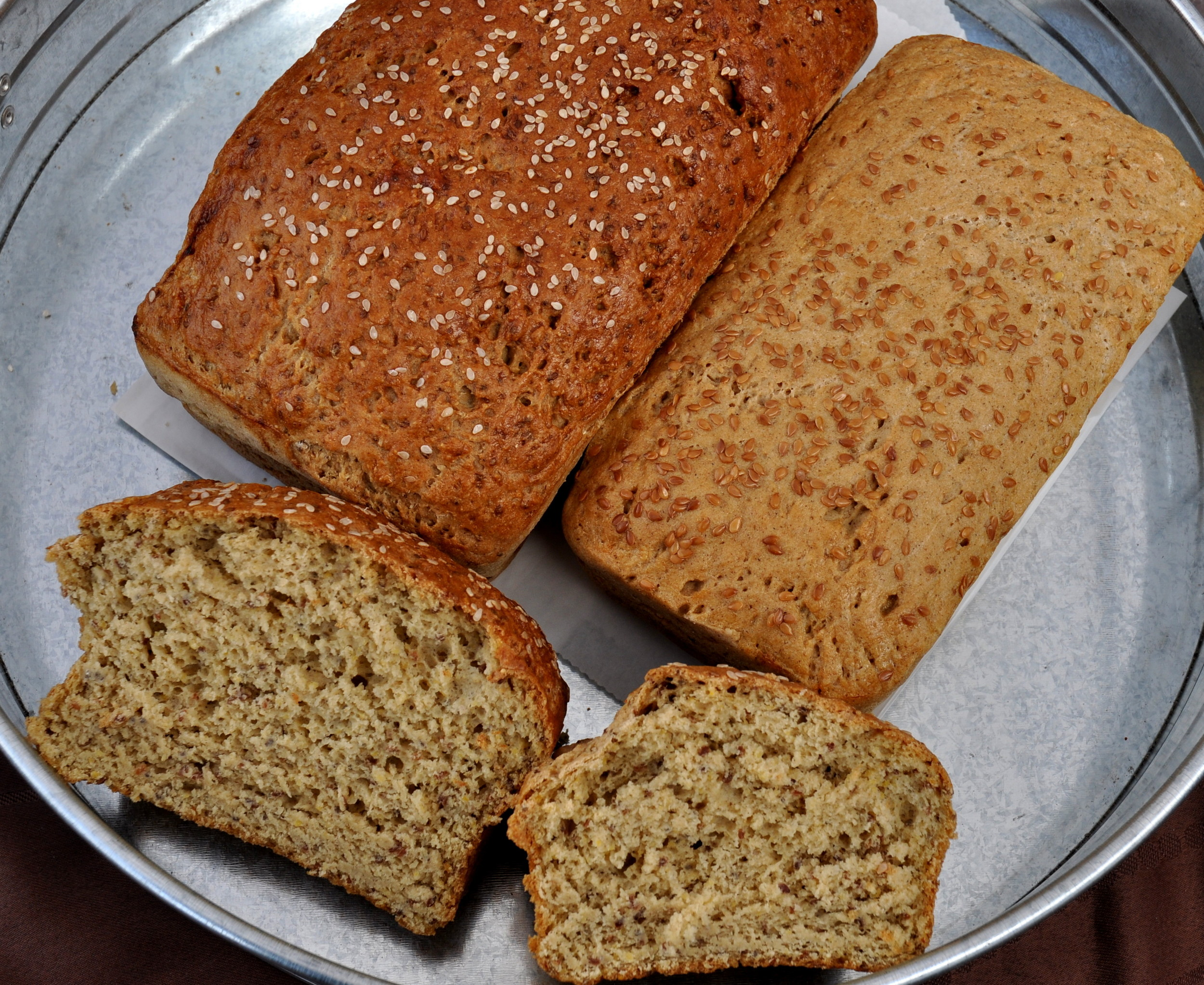 Sesame loaf (left) and whole grain sandwich bread from d:floured gluten-free bakery. Photo copyright 2013 by Zachary D. Lyons.