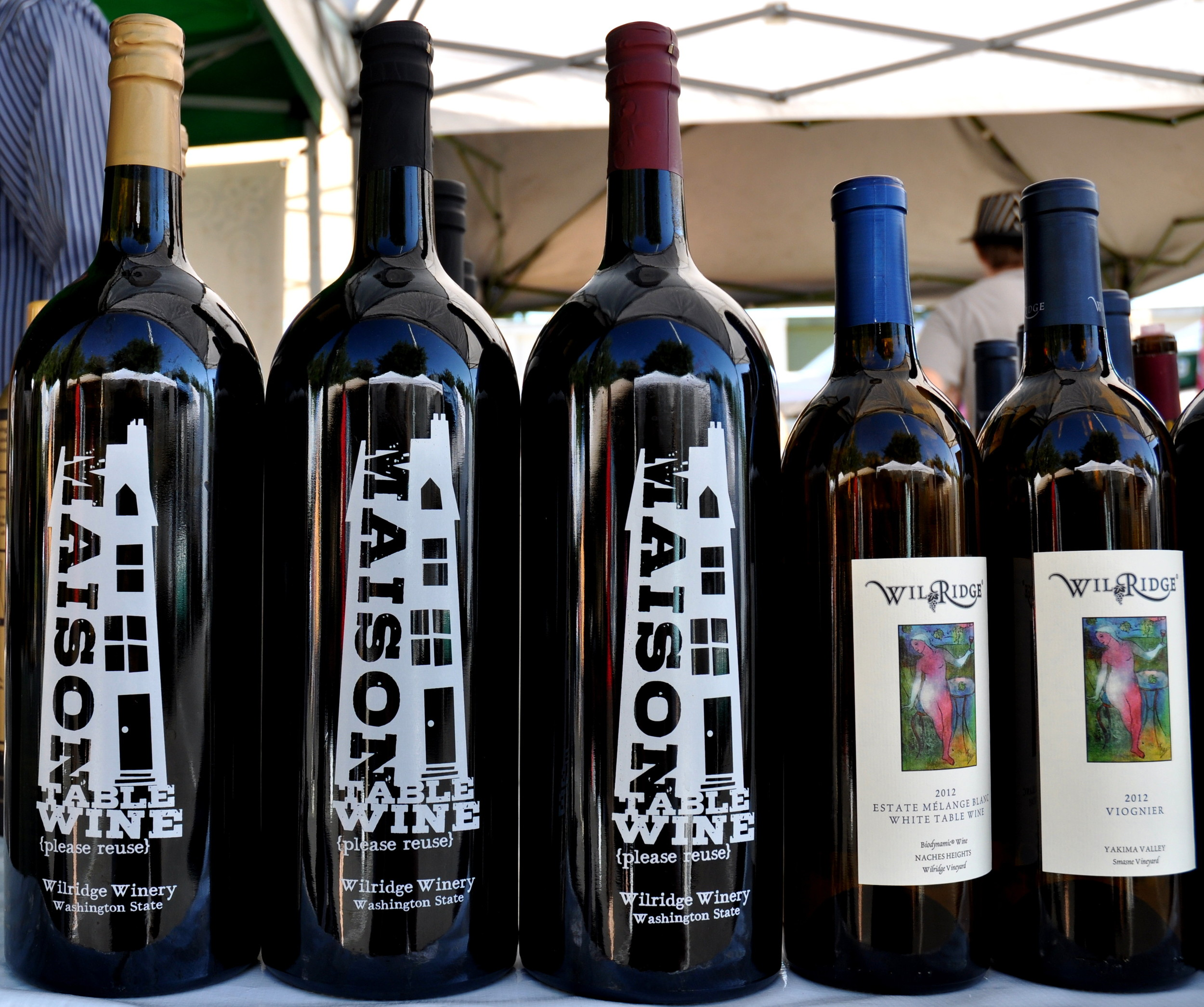 Refillable bottles (left) from Wilridge Winery at Ballard Farmers Market. Copyright Zachary D. Lyons.