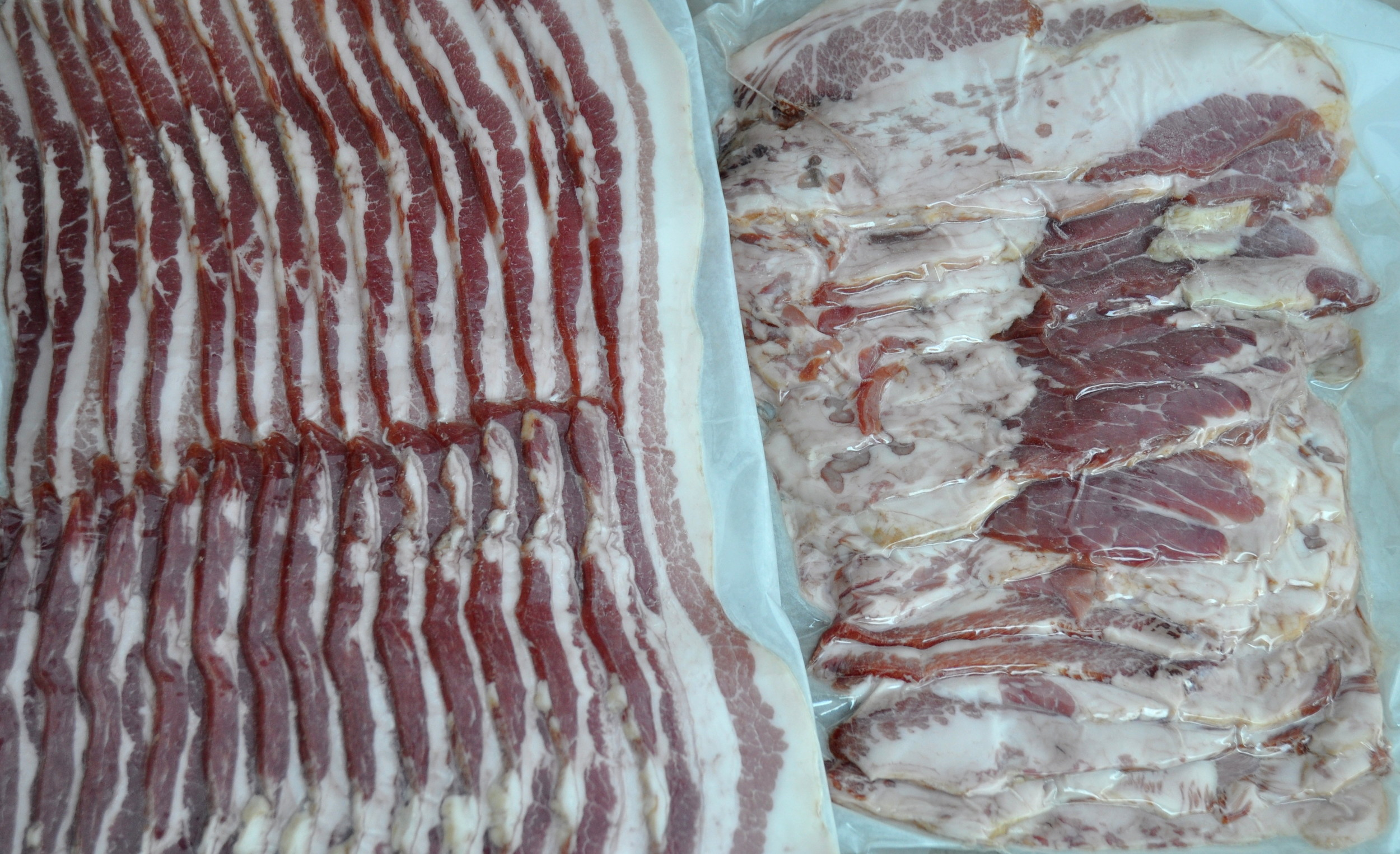 Olsen Farms pork belly bacon (left) and jowl bacon (right). Photo copyright 2013 by Zachary D. Lyons.