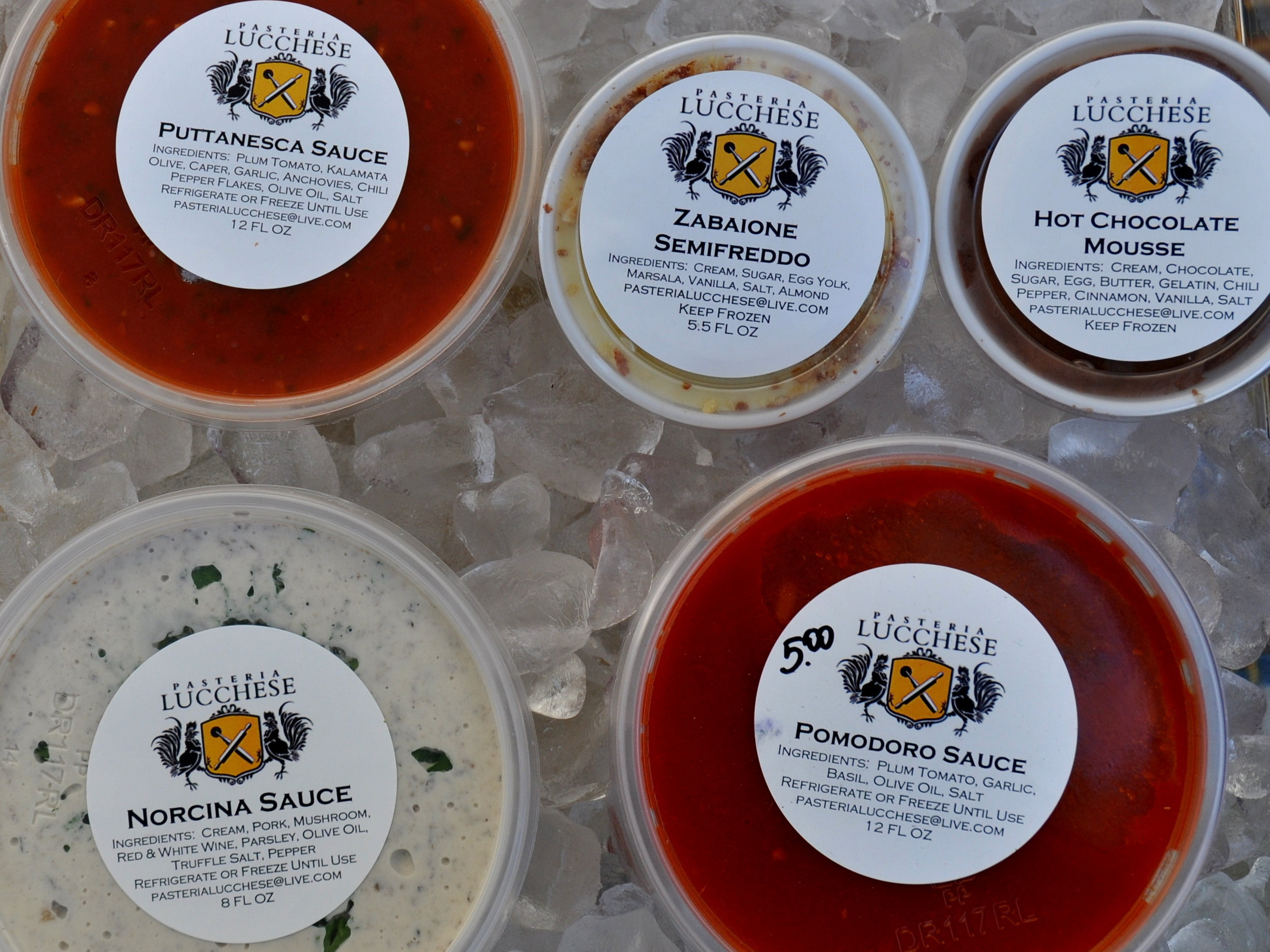 Pastas sauces and desserts from Pasteria Lucchese. Photo copyright 2014 by Zachary D. Lyons.