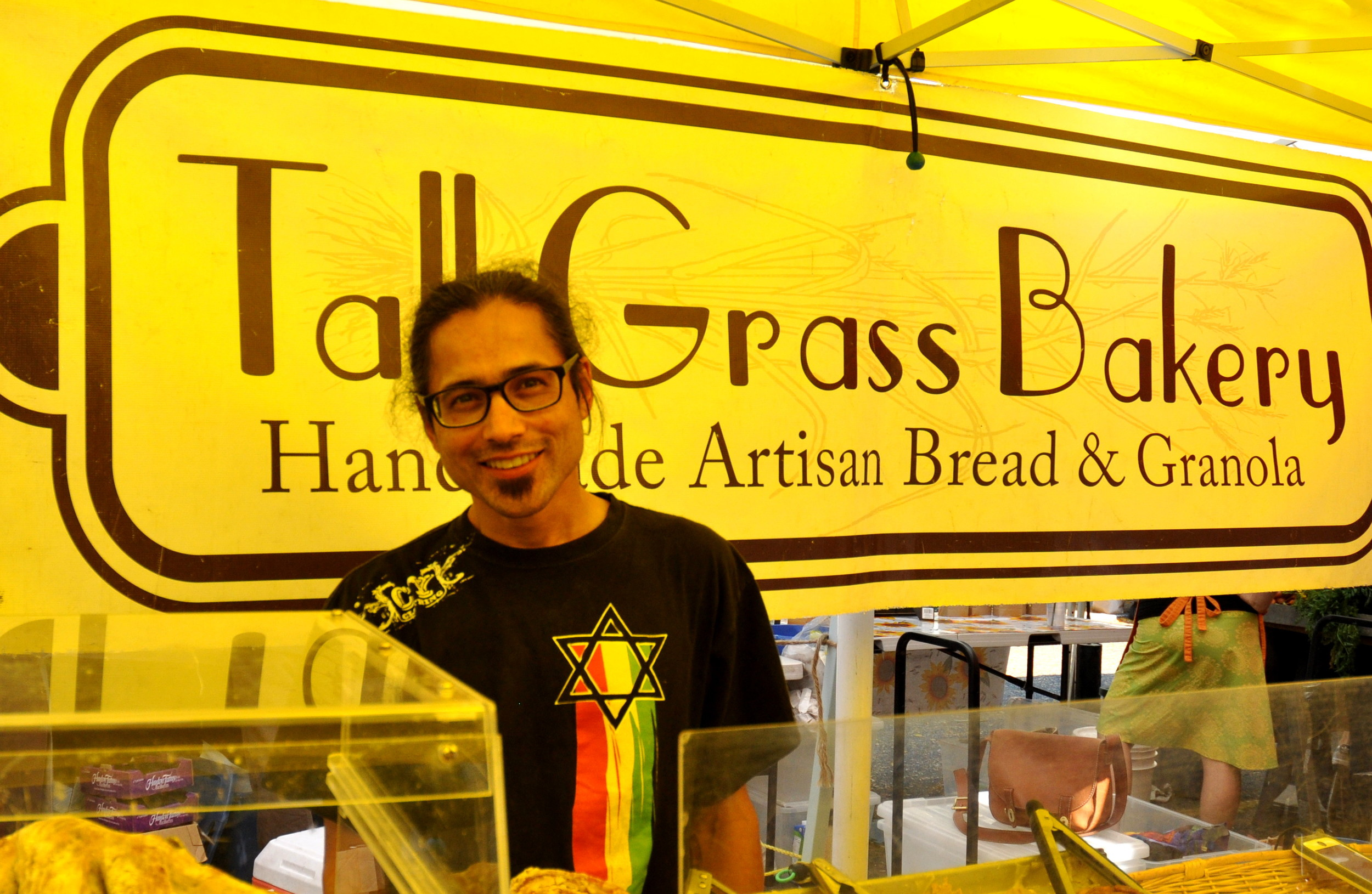 Farhad from Tall Grass Bakery at Ballard Farmers Market. Copyright Zachary D. Lyons.
