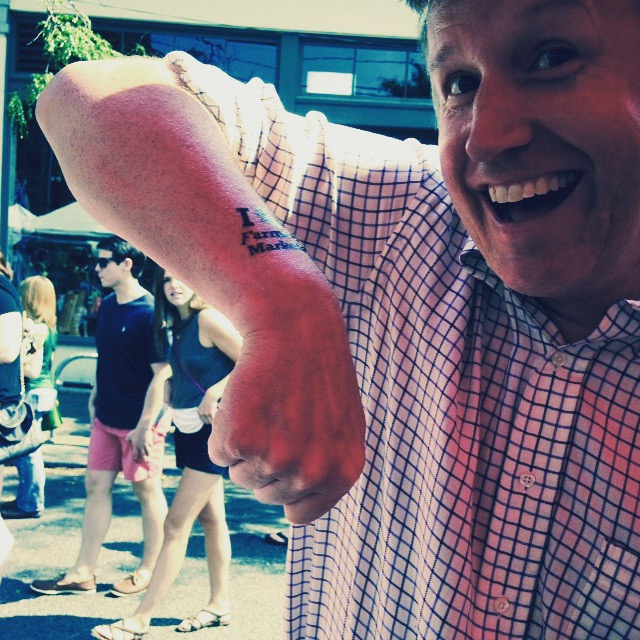 Seattle City Council member Mike O'Brien takes a campaign break with a tattoo, at Ballard.