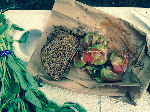Market lunch: Take two pieces of Tall Grass pumpernickel, a few leaves of arugula, a coupla slices of your favorite heirloom 'mater, and slap everything together. Boom.