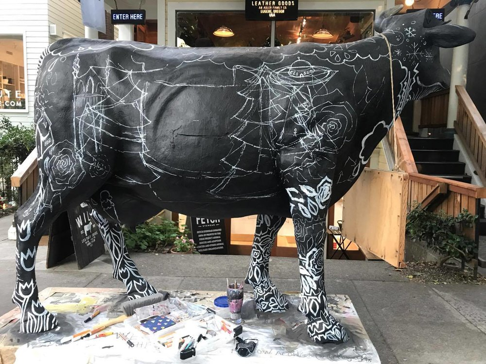 Working on freehanding the back of Will The Cow, Out in front of Will Leather Goods in portland Oregon, on nw 23rd ave.
