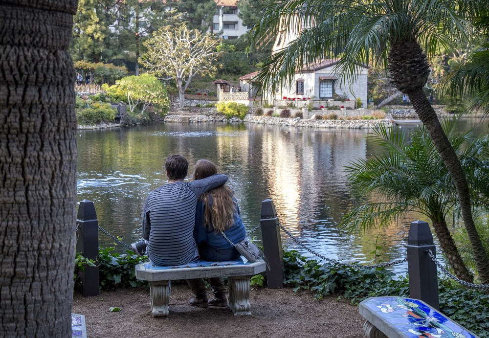 A couple embracing at the Lake Shrine
