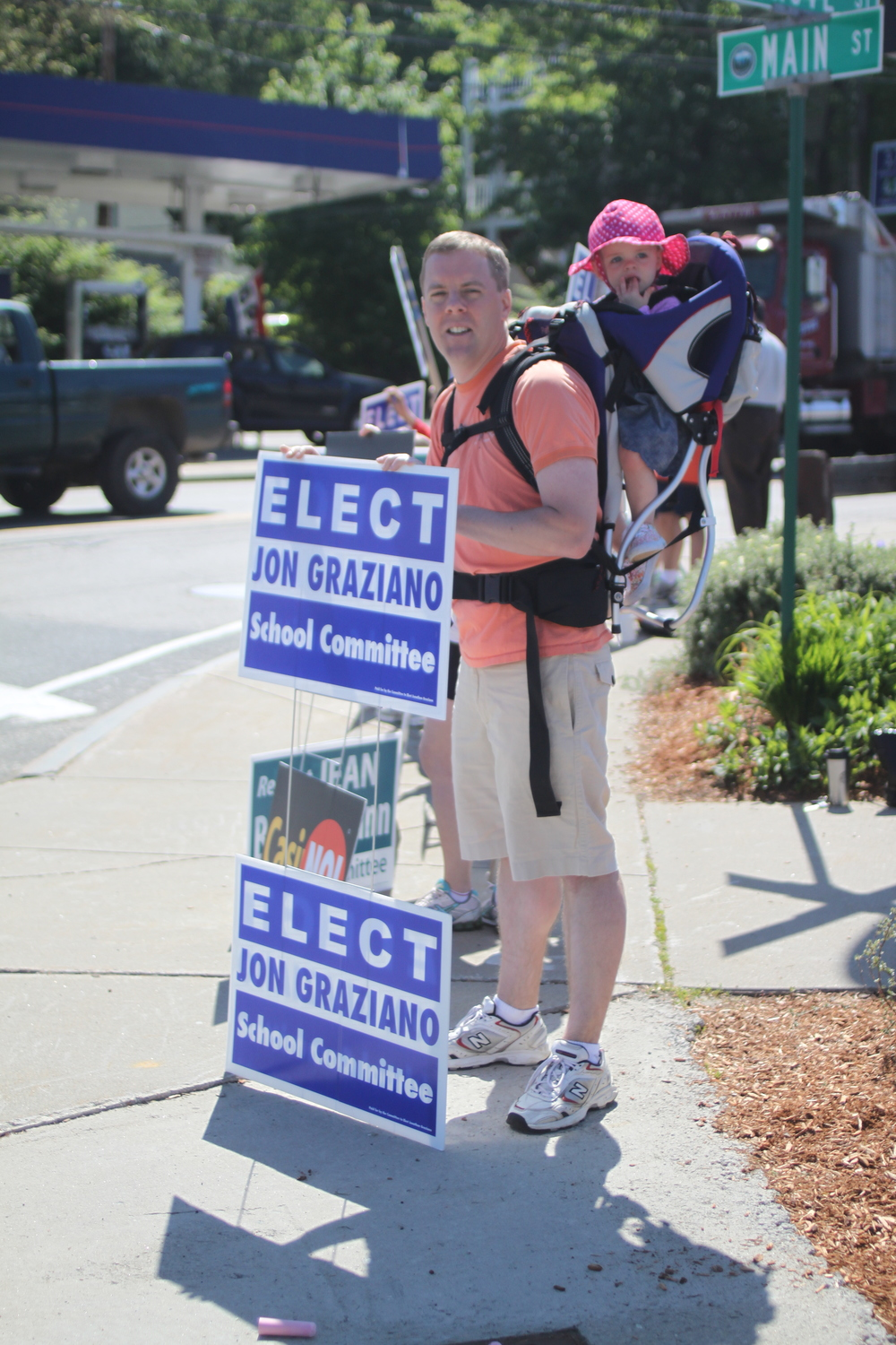 jon holding signs in 2012 for his school committee campaign.