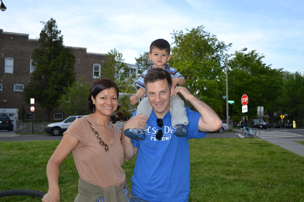 Monica, Carl and 19-month old Thoreau enjoying meeting their neighbors.
