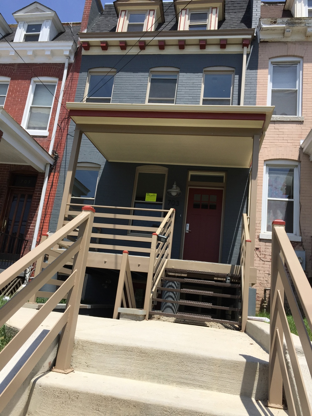 Newly renovated 703 Upshur St NW has a nice yellow Vacant Property sticker.