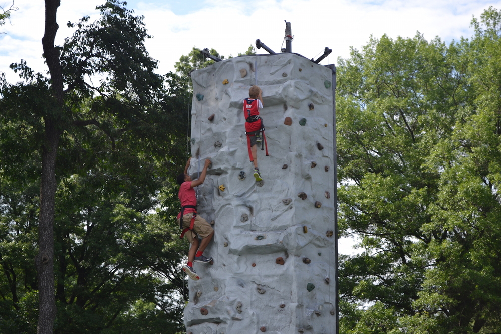 The kids make the rock climbing wall look easy.