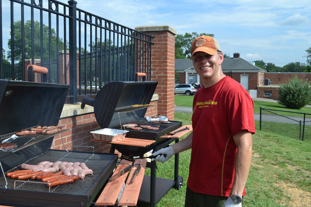 Brad Ness working hard over the barbecues, making hot dogs, hamburgers and bratwurst.