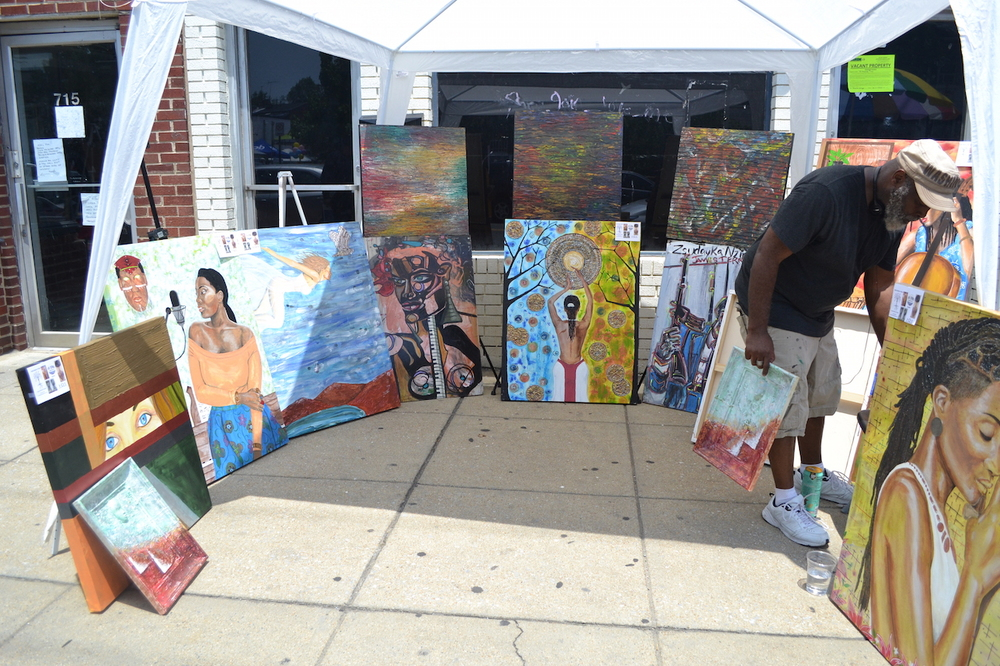 Hebron Chism's booth of artwork.