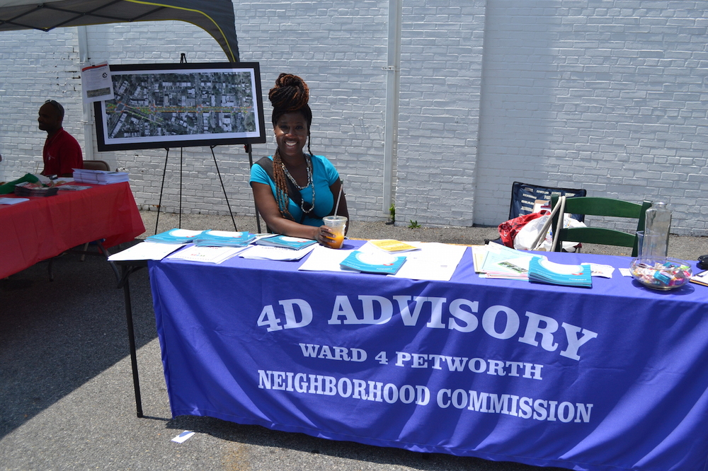ANC 4D Commissioner Krystal Branton braving the heat to talk to constituents.