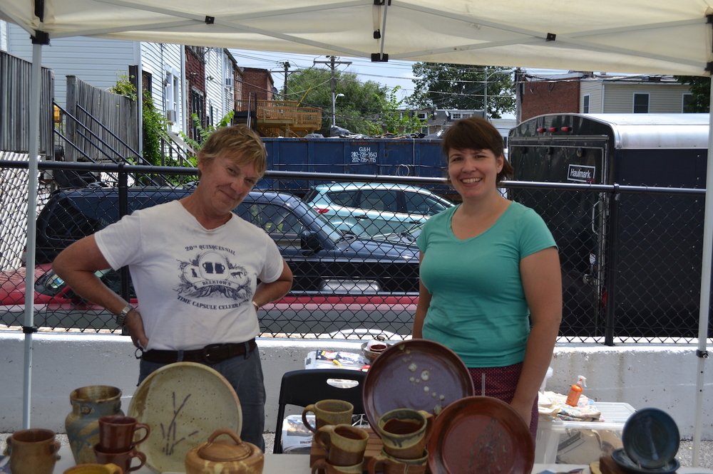 Carol Herwig and Sam Gordon selling their hand-crafted pottery.