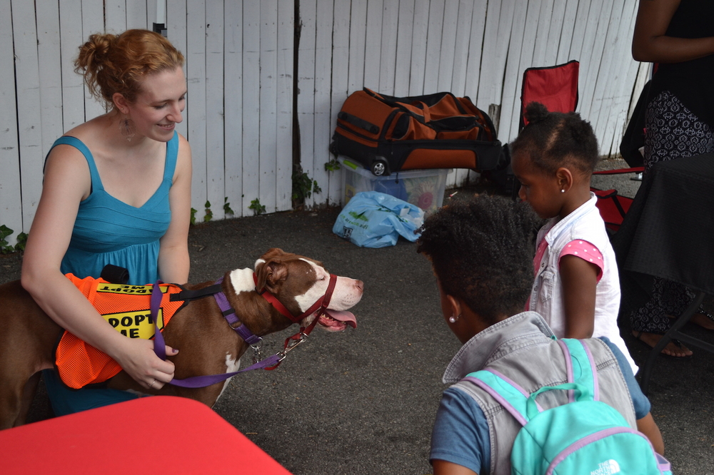 Emily and Mango greet a little girl and her mom.