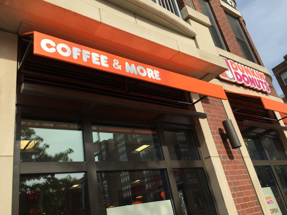 Why is Coffee & More left aligned on this signage? Don't they know this will bother me every single time I see the store?