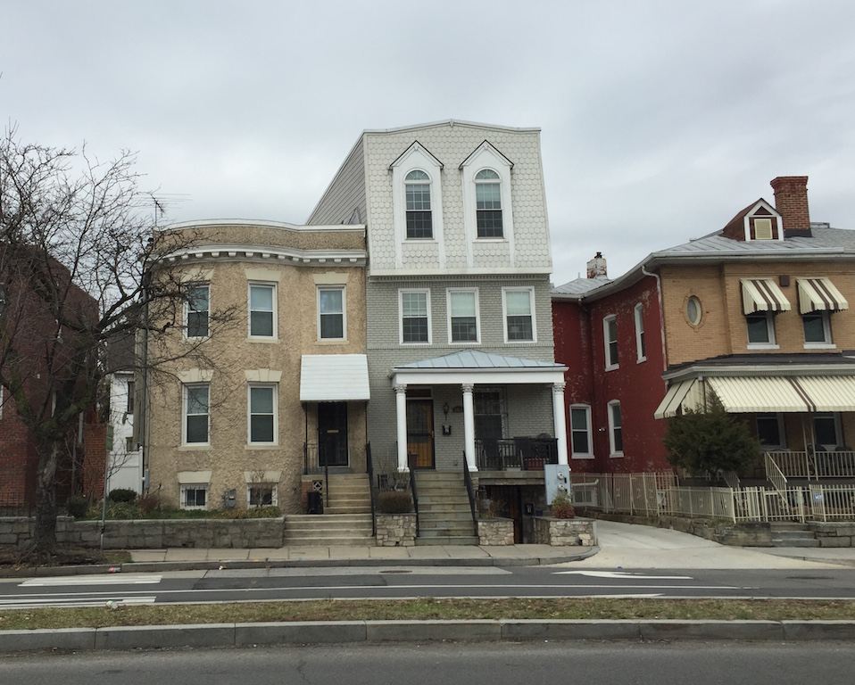 A terribly designed pop-up conversion on Sherman Avenue. The house looks perpetually surprised to me.