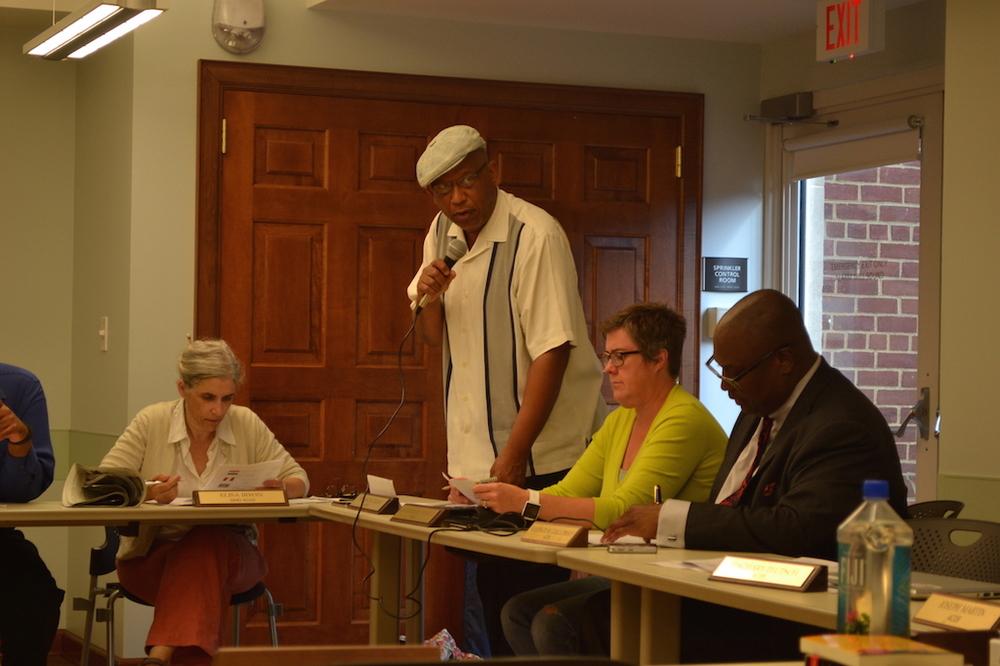 Commissioners Elisa Irwin (seated, left) Taalib-Din Uqdah, Kathleen Crowley and Vann-Di Galloway