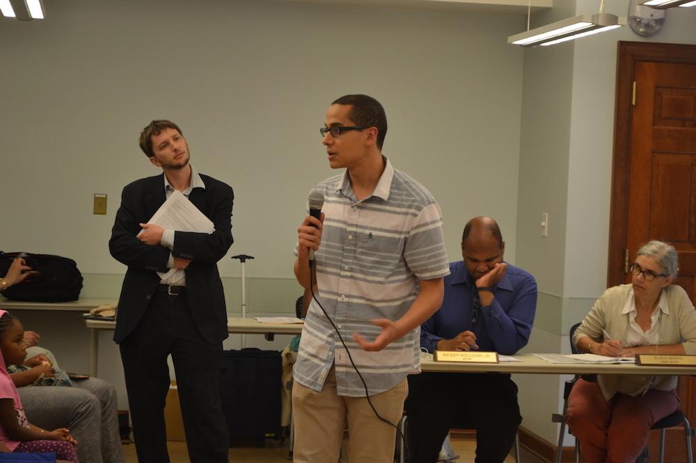 Christian speaking, Mark in the back.