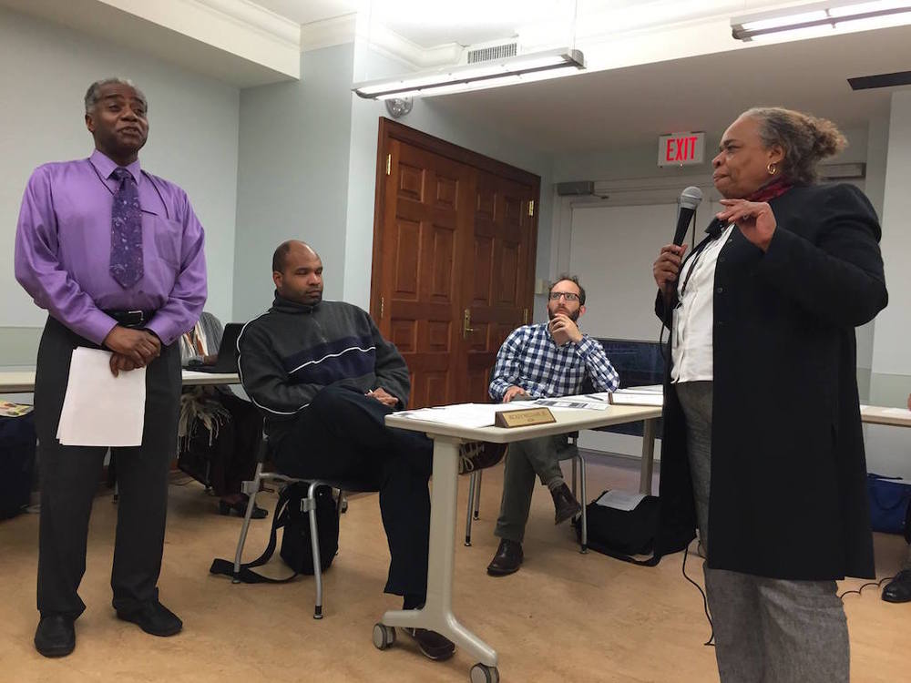 Douglas Stallworth from WMATA talks with resident Milicent Toya about the proposal for an express bus on 14th Street at the April 8, 2015 ANC 4C meeting.