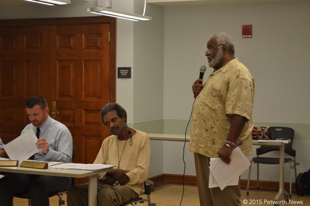 Commissioners John-Paul Hayworth, Timothy Jones and resident Grayson Dixon