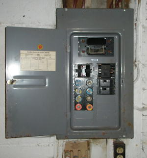 An old fuse box that needs replacement