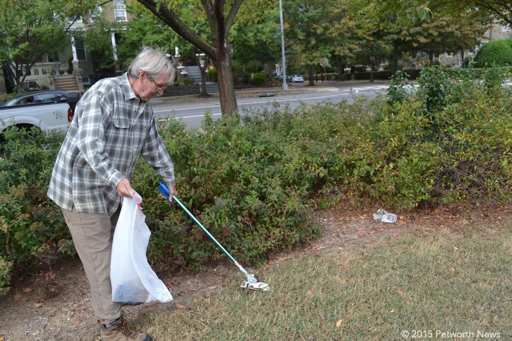 George Morgan picking up trash
