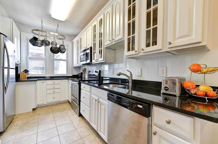 A large kitchen offers stainless steel appliances and granite countertops.