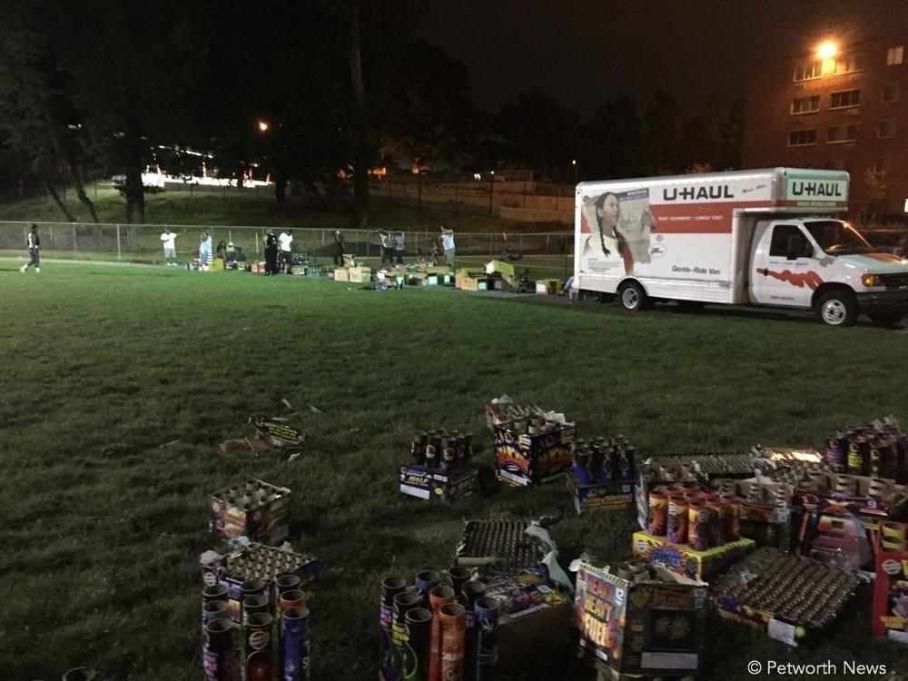 On the ball field across from Powell Elementary on Upshur Street. They brought all these fireworks via the U-Haul truck, much to the enjoyment of the crowd.