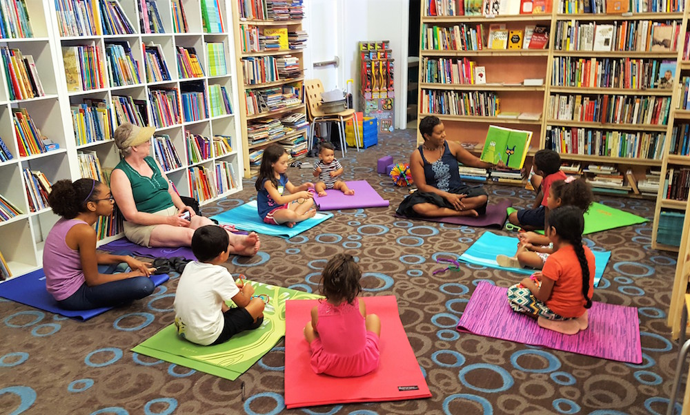 Kids' yoga in the rear of the store   (photo courtesy Walls of Books)
