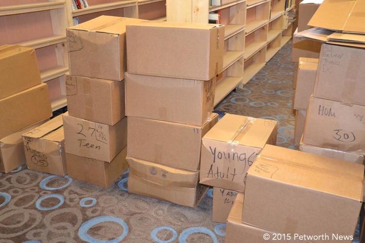 Boxes and boxes of books arrive, ready for stocking the shelves