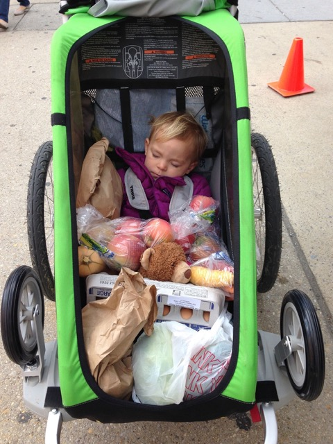 Little Amery snuggling with the groceries