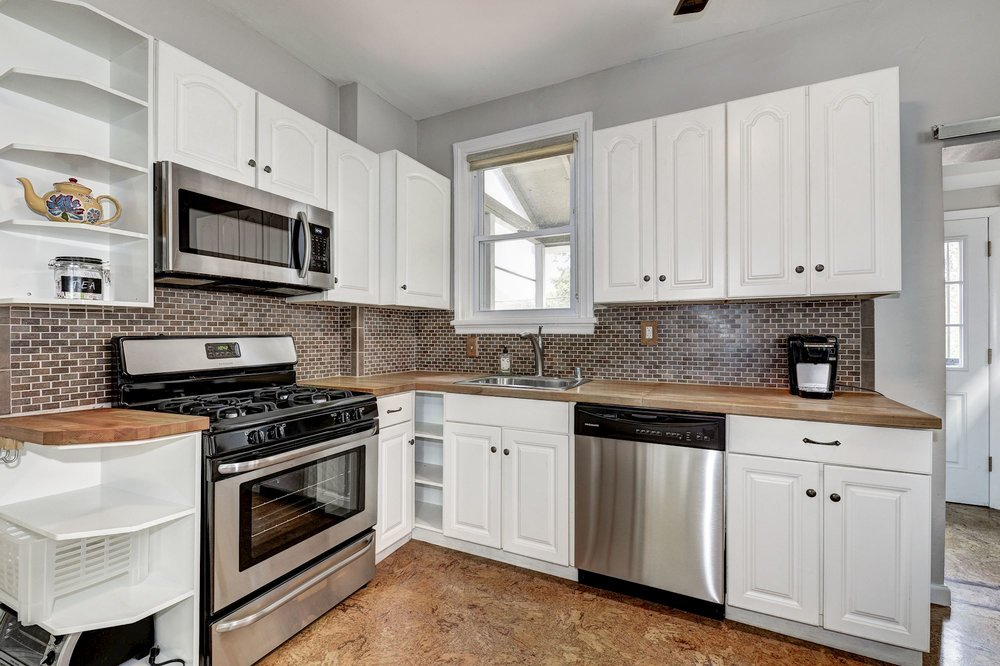 Lots of storage and stainless steel appliances.