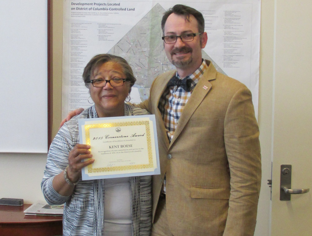 At-Large Councilmember Anita Bonds awarding a Cornerstone Award to Commissioner Kent Boese for his community service.