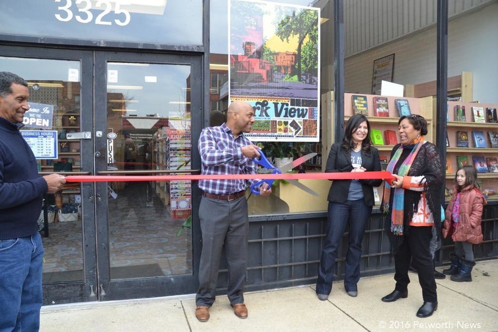 Pablo Sierra cutting the ribbon at the grand opening in February 2016
