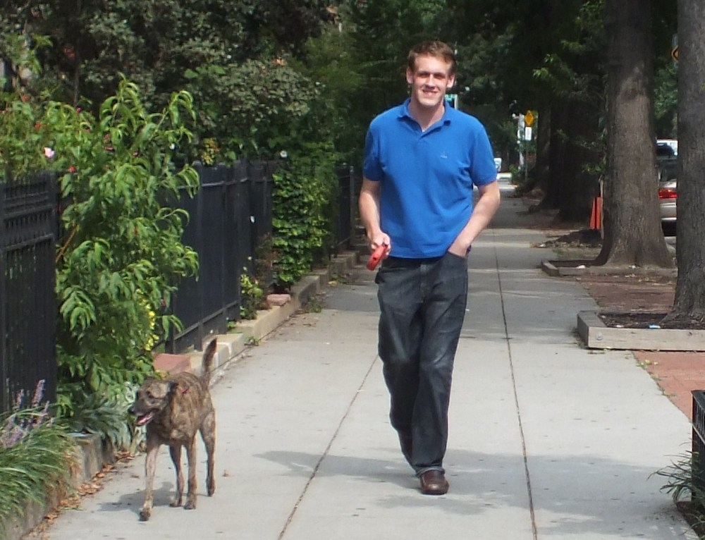 Owner Patrick Flynn walking one of his furry customers.