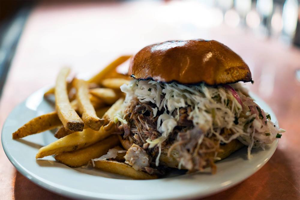 Hot pulled pork and fries deserves a beer to come along