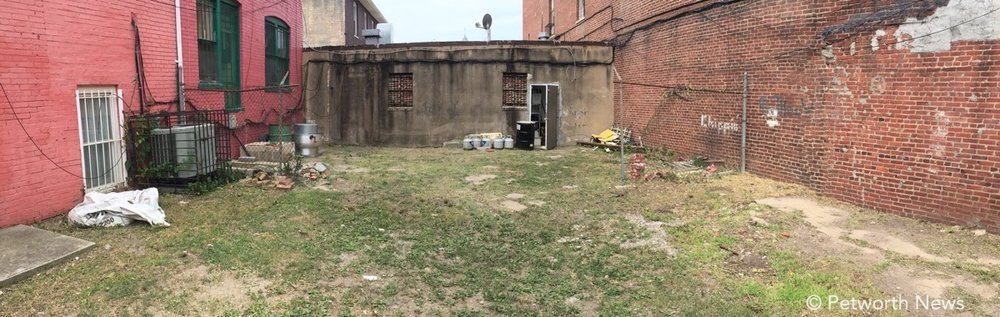 A panorama shot of the back space behind 843 and 845 Upshur St