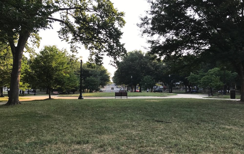 A view of the park and all four benches around Sherman Circle