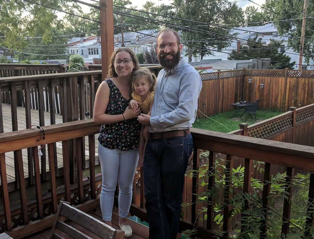 Zach Teutsch and his family in the backyard of their Petworth home.