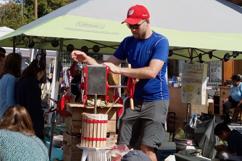 Jared Fackrell pressing apples at the 2017 Celebrate Petworth Festival