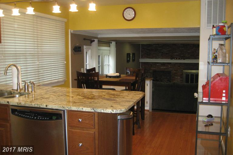 BEFORE - Kitchen looking into dark room.jpg
