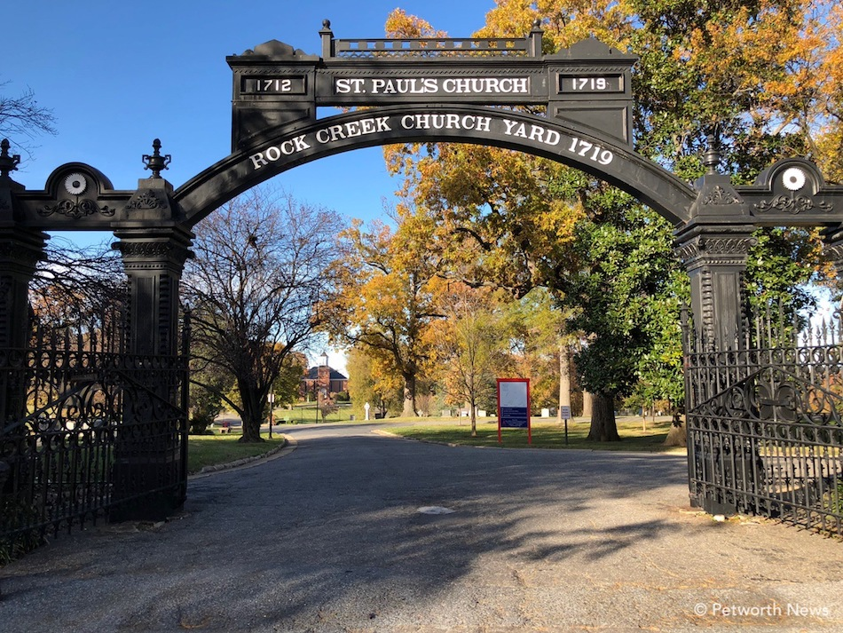 The gates of Rock Creek Church Cemetery, with the parish visible in the distance.