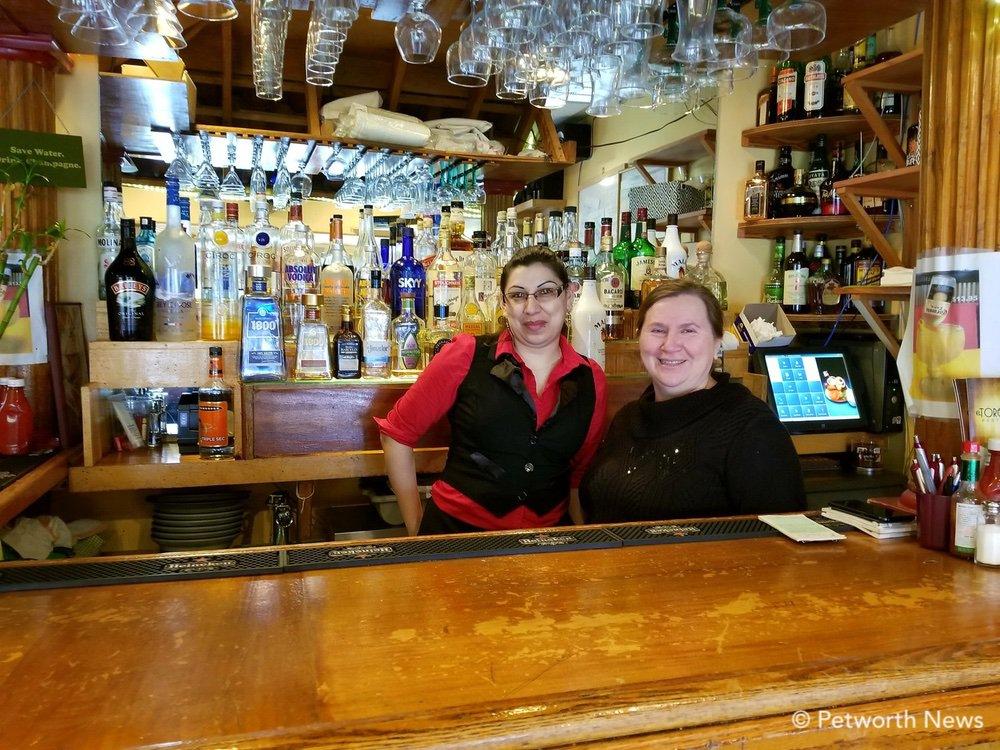 El Torogoz manager Coralia Ventura (right) poses with an El Torogoz waitress.