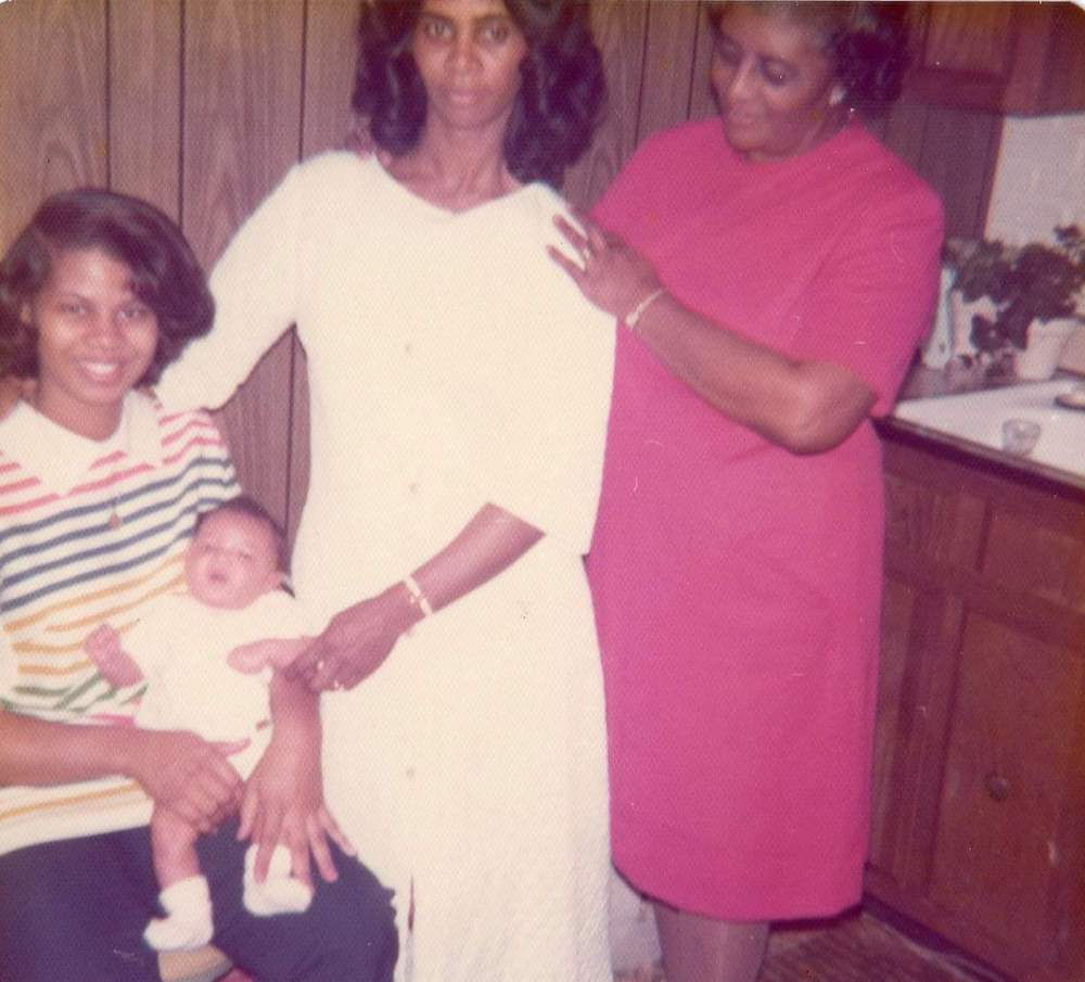 Cinyon Reed, being held by her mother, with grandmother Sandra Gray Bundy, and her great-grandmother