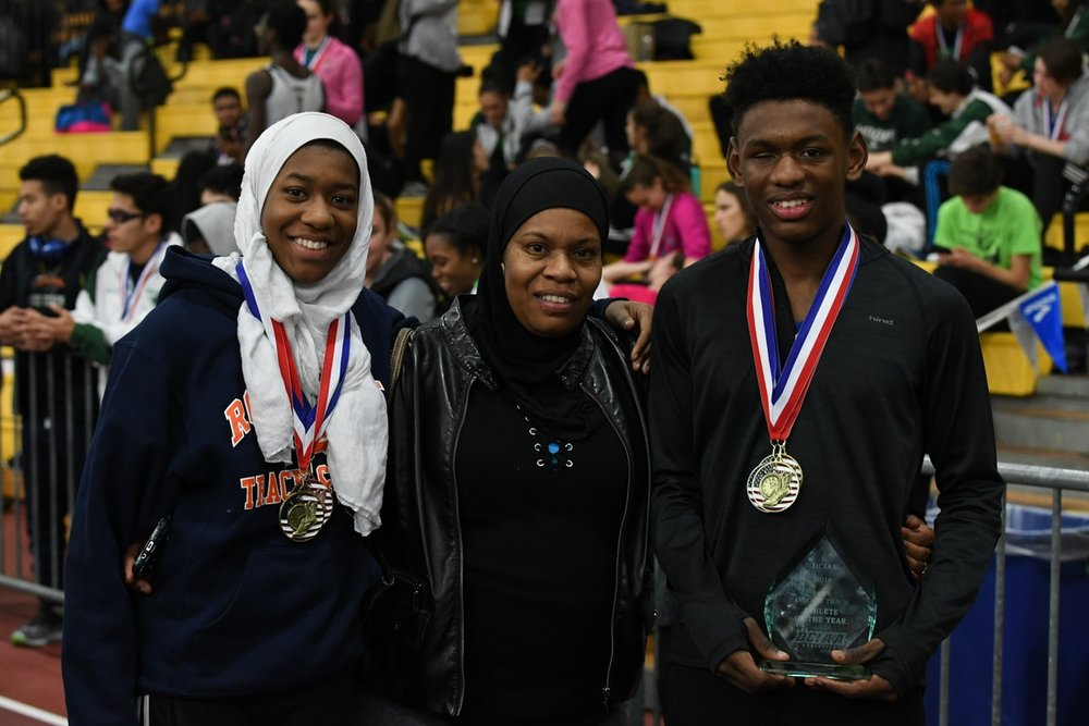 Taahir posing with his sister and mother after a race this year and receiving Athlete of the Year award. (photo courtesy of Taahir Kelly)