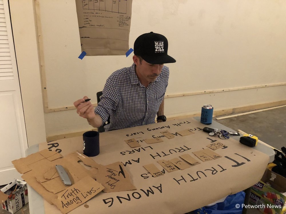 Tom Pipkin sketching out art placement for the Truth Among Liars events.