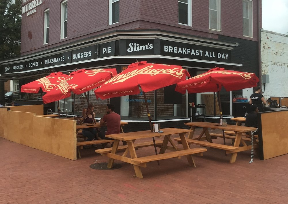 The new tables and umbrellas at Slim's outdoor beer garden.