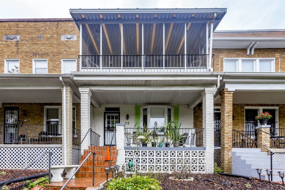 29 Sherman Circle NW is with a screened-in second floor porch.