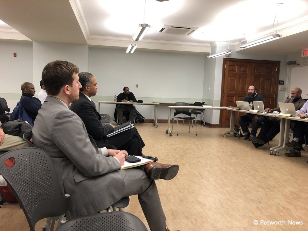 Commissioner Zach Teutsch speaking as Councilmember Brandon Todd listens.